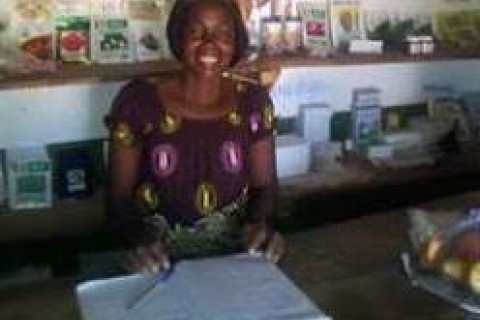 Nelia Banda taking inventory at her store in Petauke, Zambia