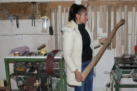 Dragana Stojinić in her workshop, where she crafts wooden handles for tools in Prijedor, BiH.