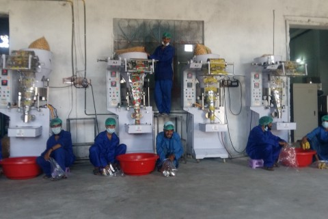 Sail Food Company workers use the new packing machines