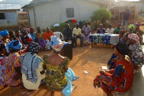 Women Sit in a Circle at a Village Savings and Loan Meeting