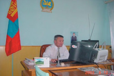 Chief Judge of the Dornod Aimag court at his office working on this computer through a local area network.