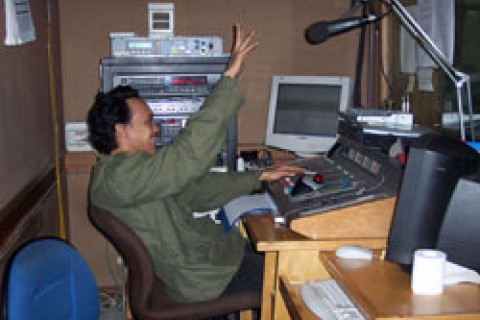 Radio News 68H technician Joni Yohanes broadcasting news that reaches eight million men and women across Indonesia and throughou