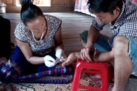 HIV testing being provided in a rural Vietnamese home by a lay provider.