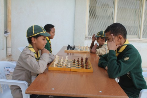 Youth take part in a chess tournament at Sabha's Al Nahda Sports Club.