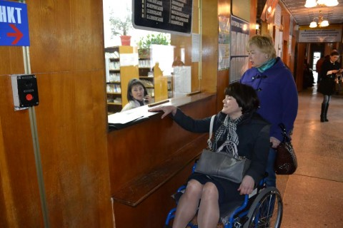 A visitor at the registration window in Vinnytsia Oblast Hospital.