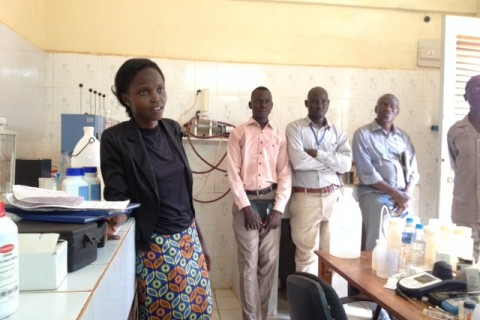 Tivo Abowro Chol describes the water quality testing process of her lab at the Wau Water Corporation.