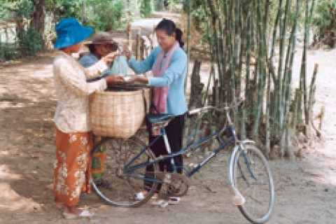 Lorn sells watermelons and mangos in Tanuk village in western Cambodia. Since a USAID-sponsored HIV/AIDS awareness program visit
