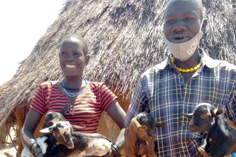 Aretho and Lojo show off the goats in Aretho's care.