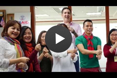 USAID/Vietnam Staff and Partners Use Sign Language to Express Support for Persons with Disabilities