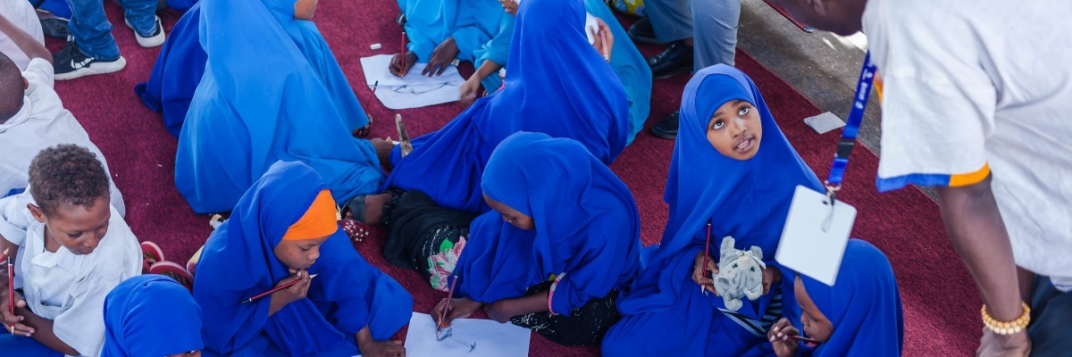 Students participate in a drawing workshop at the Mogadishu Book Fair. Ismail Taxta, UNICEF/Somalia