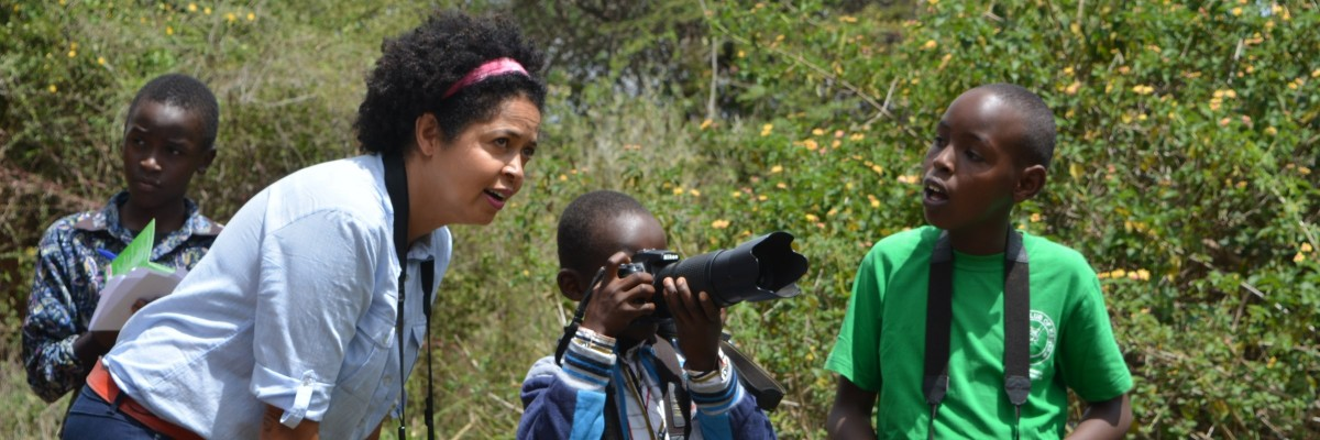 Dr. Paula Kahumbu taking children on a bird walk at Mpala Ranch in Nanyuki.