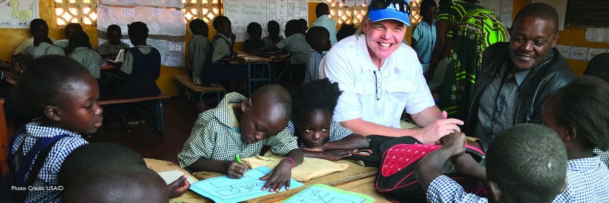 USAID education programs aim to increase learners' performance in the early grades, and target foundational literacy skills.  Photo: During a three-day visit to North-Western Province, U.S. Ambassador to Zambia Daniel L. Foote visited with students at Nswanakudya Primary School, a beneficiary of USAID Let's Read project, which is designed to help improve literacy levels for children in pre-primary (kindergarten) through Grade 3.
