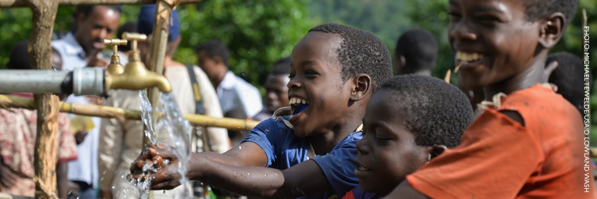 Image of Ethiopian boys accessing safe drinking water
