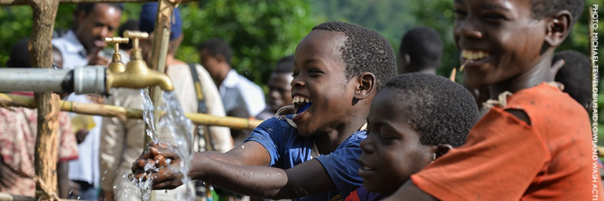 Image of Ethiopian boys accessing clean drinking water.