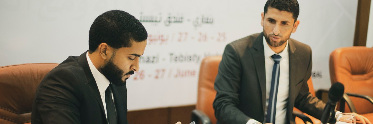 Libyan men converse together during a Civil Society and Local Development event.
