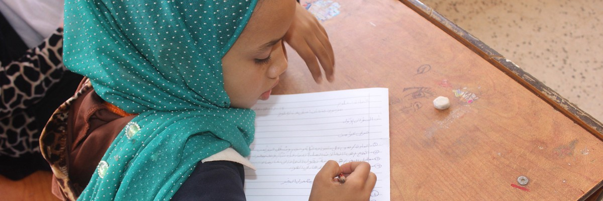 A Young Student Completes an Assignment at School in Libya. Photo: ©UNDP Libya/ Ali Alshareef.