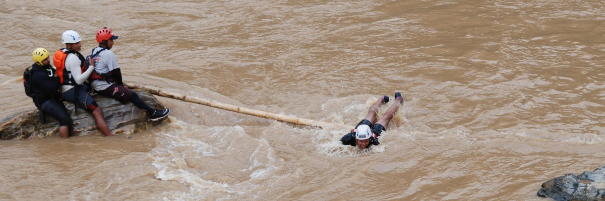 Trainees participate in a mock rescue drill during Swift Water Rescue Training. Photo by National Society for Earthquake Technology-- Nepal for USAID.
