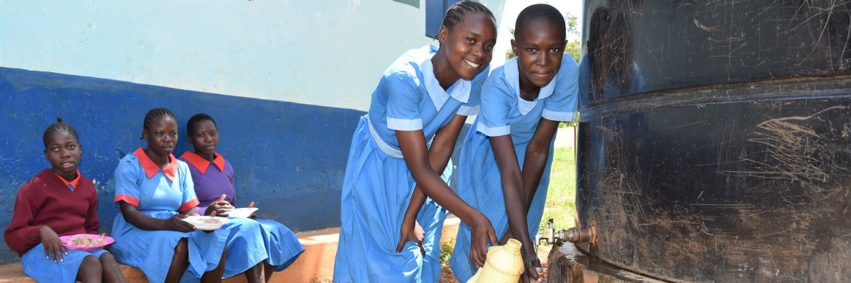 Pupils at Murende Primary School in Busia County, fetching water at a point within the school. The water is provided by the Sisenye Water Project which serves approximately 15,000 people with access to clean water and sustainable services.