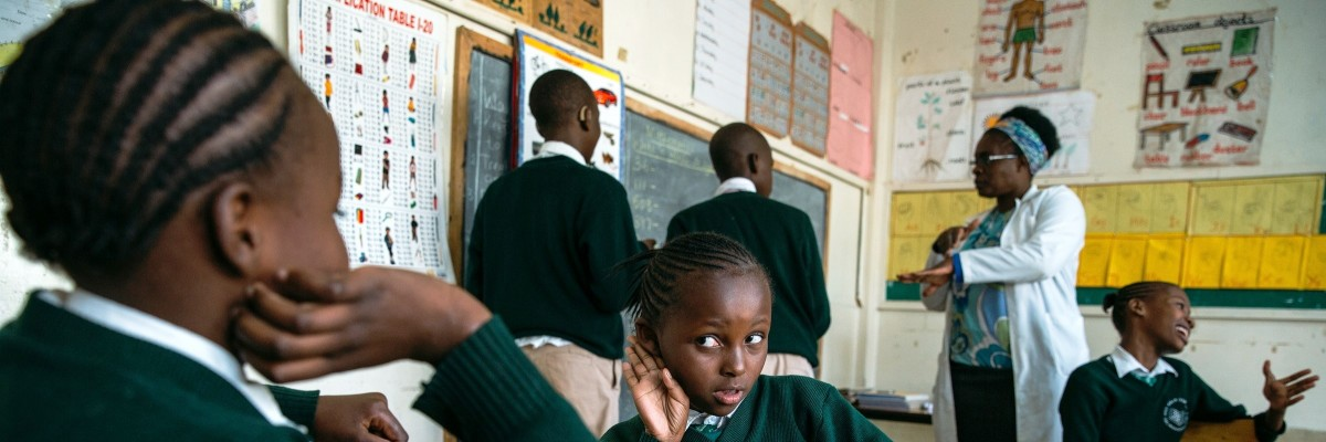 Aga Khan Primary School pupils with hearing impairment in Nairobi County sign during a class. USAID's Early Grade Reading program supports literacy for children with disabilities in grades 1, 2, and 3 in all public primary schools in Kenya.