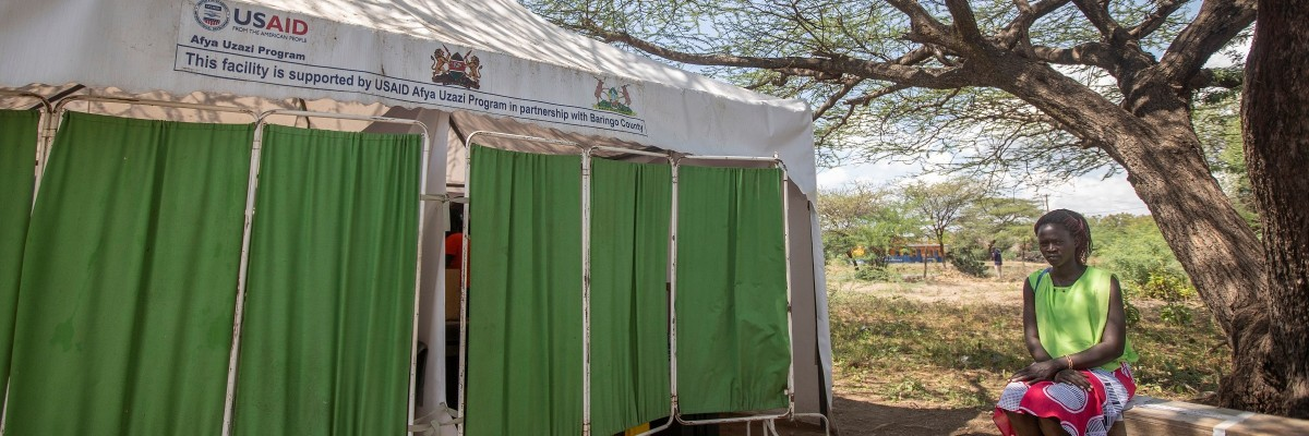 Ashley Koros is 7 months pregnant and waiting to be served at the newly relocated Kampi Ya Samaki Dispensary, Baringo County. Due to rising water levels in Lake Baringo, the former health facility was evacuated.