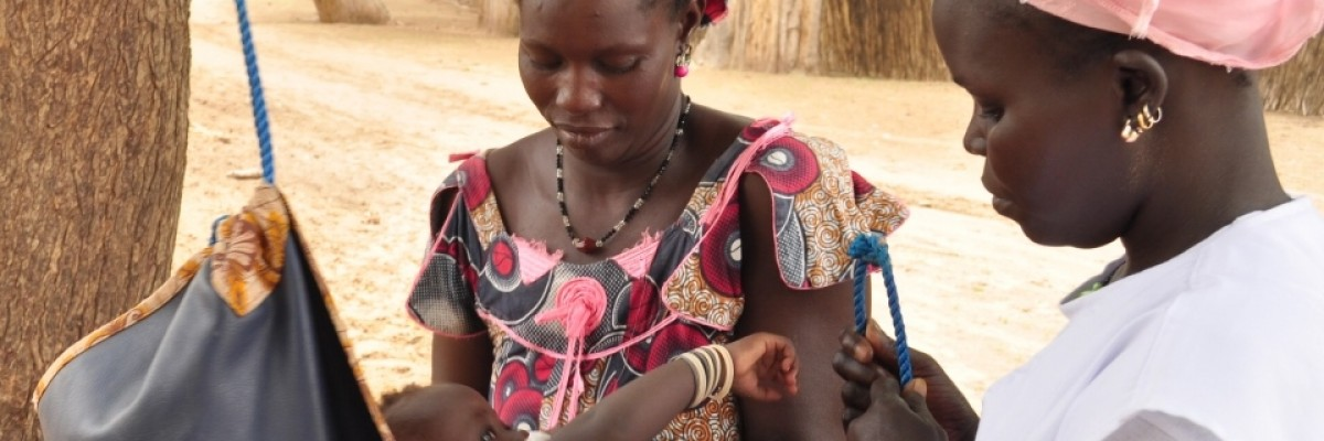 Mbène Dionne weighs village babies to ensure they are not underweight