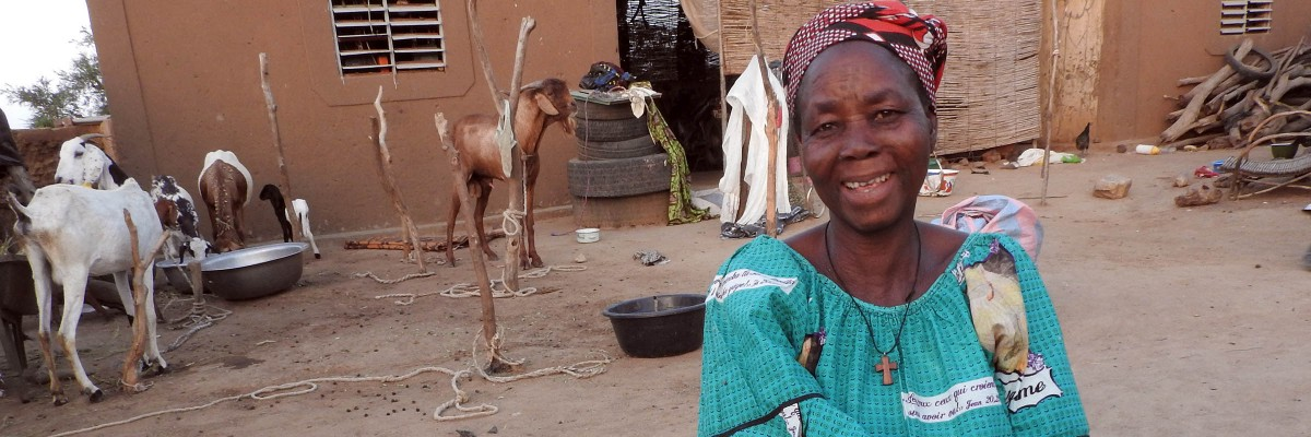 A Burkinabe woman showing off the goats she raised