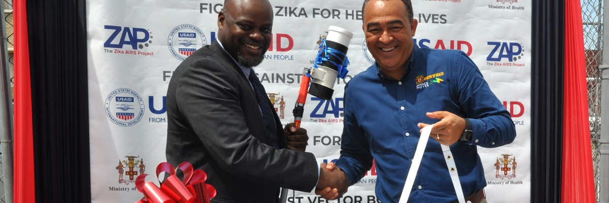 USAID/Jamaica Country Representative Jason Fraser, hands over state-of-the-art Zika equipment to the Minister of Health, Dr. The Honorable, Christopher Tufton, to boost efforts to combat, mosquito-borne illnesses.