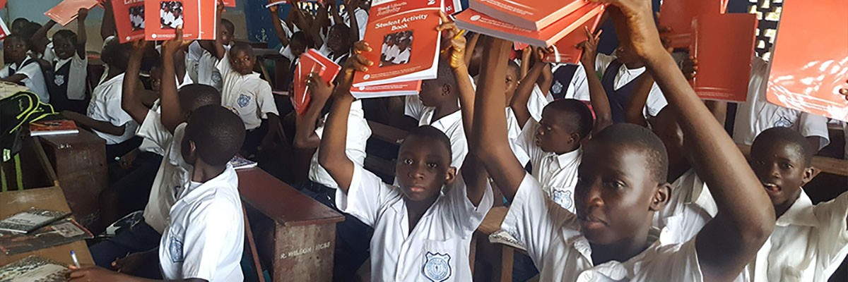 Liberians children with USAID-funded reading materials