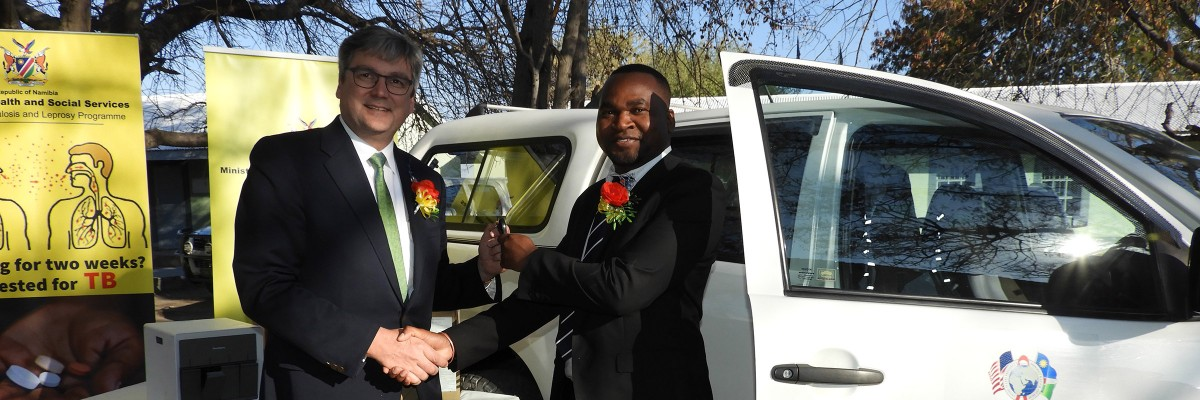 USAID Country Representative, Dr. Randy Kolstad, handing over a 4x4 vehicle and cartridges for the GeneXpert TB diagnostic machine to Mr. Tomas Ukola, Deputy Director of Special Programs in the Ministry of Health and Social Services