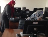 Women in Yefren information center.