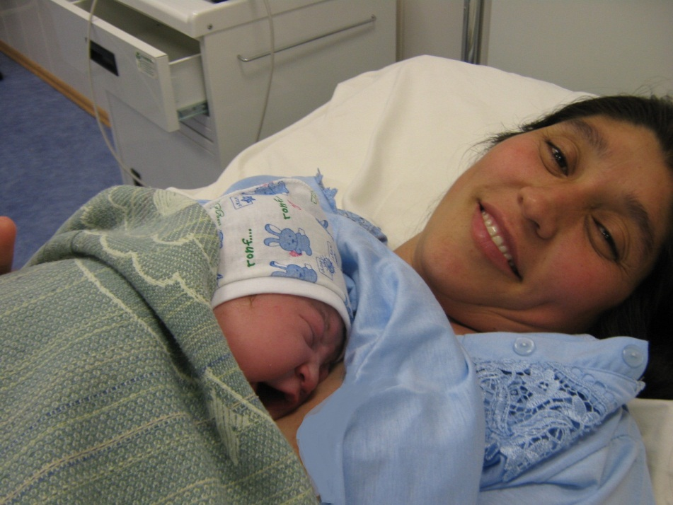 A patient at Turkmenistan's Ene Myakhri Maternity Hospital after her successful and comfortable birth.
