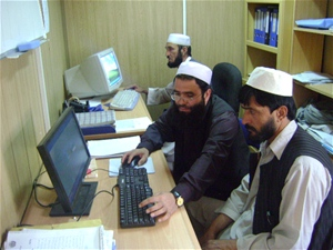 Employees of the Gardez Water Supply Department hard at work in their refurbished offices on new computers – both financed by a