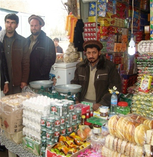 Cartons of eggs stand in the front of Abdul Naser's market stall in Kishim, Badakhshan Province.