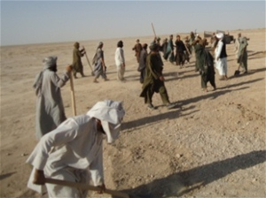 Workers from Joee Safeed Village prepare their road for graveling.
