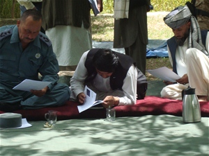 Attendees of the Loya Jirga in Kahmard District in Bamyan Province examining the proposal for a 164 kilometer road that is plann