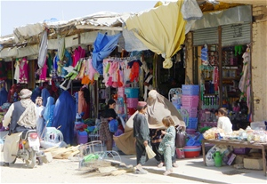 Qalat residents shop with greater ease thanks to paved pedestrian pathways and rehabilitated drainage.