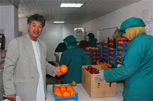 Merajudin Amiri, Operations Manager of Tak Dana Food Processing Company, inspects their produce.
