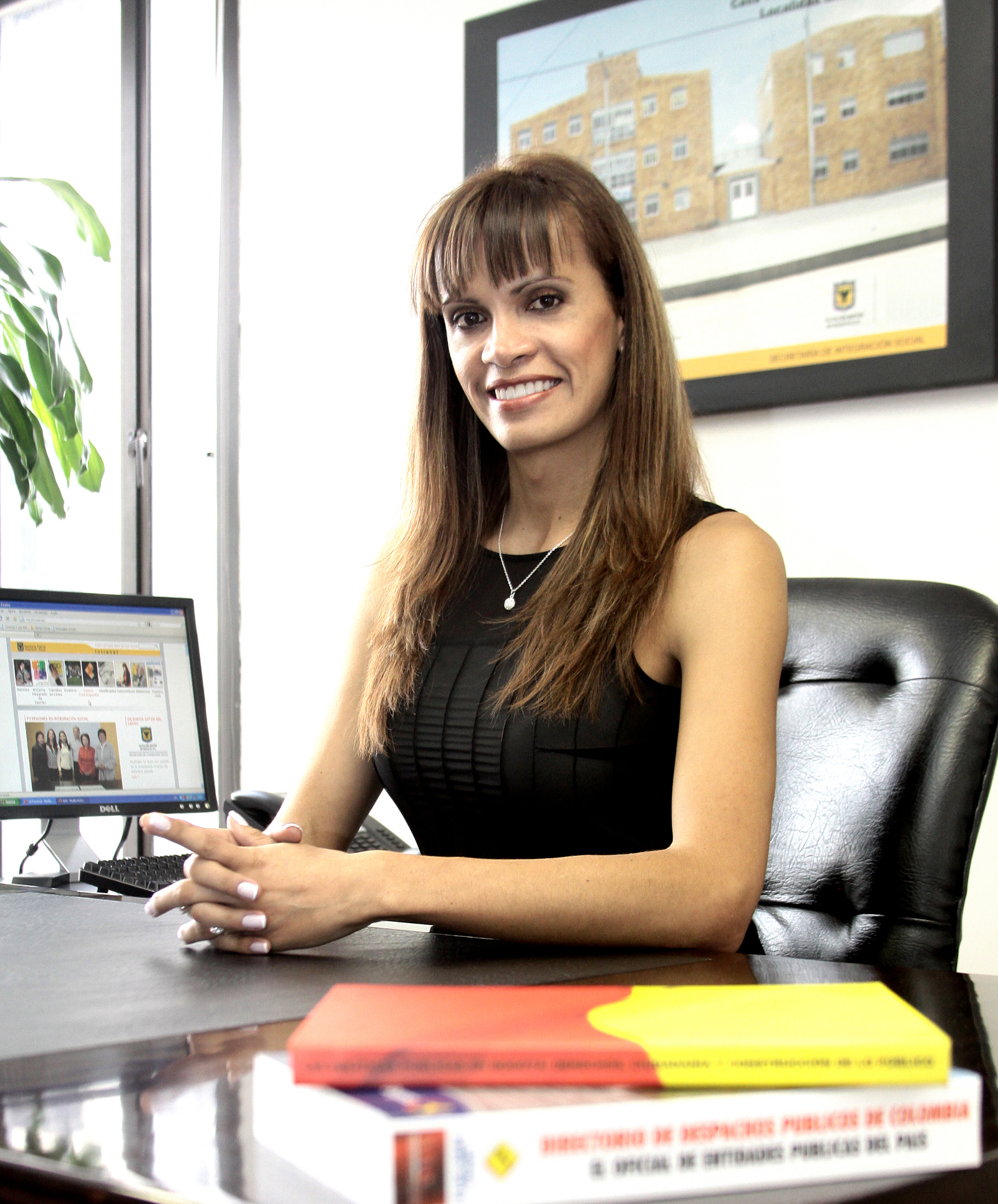 Tatiana, a beneficiary of LGBT leadership training, working at her position in the Mayor's office in Bogota.