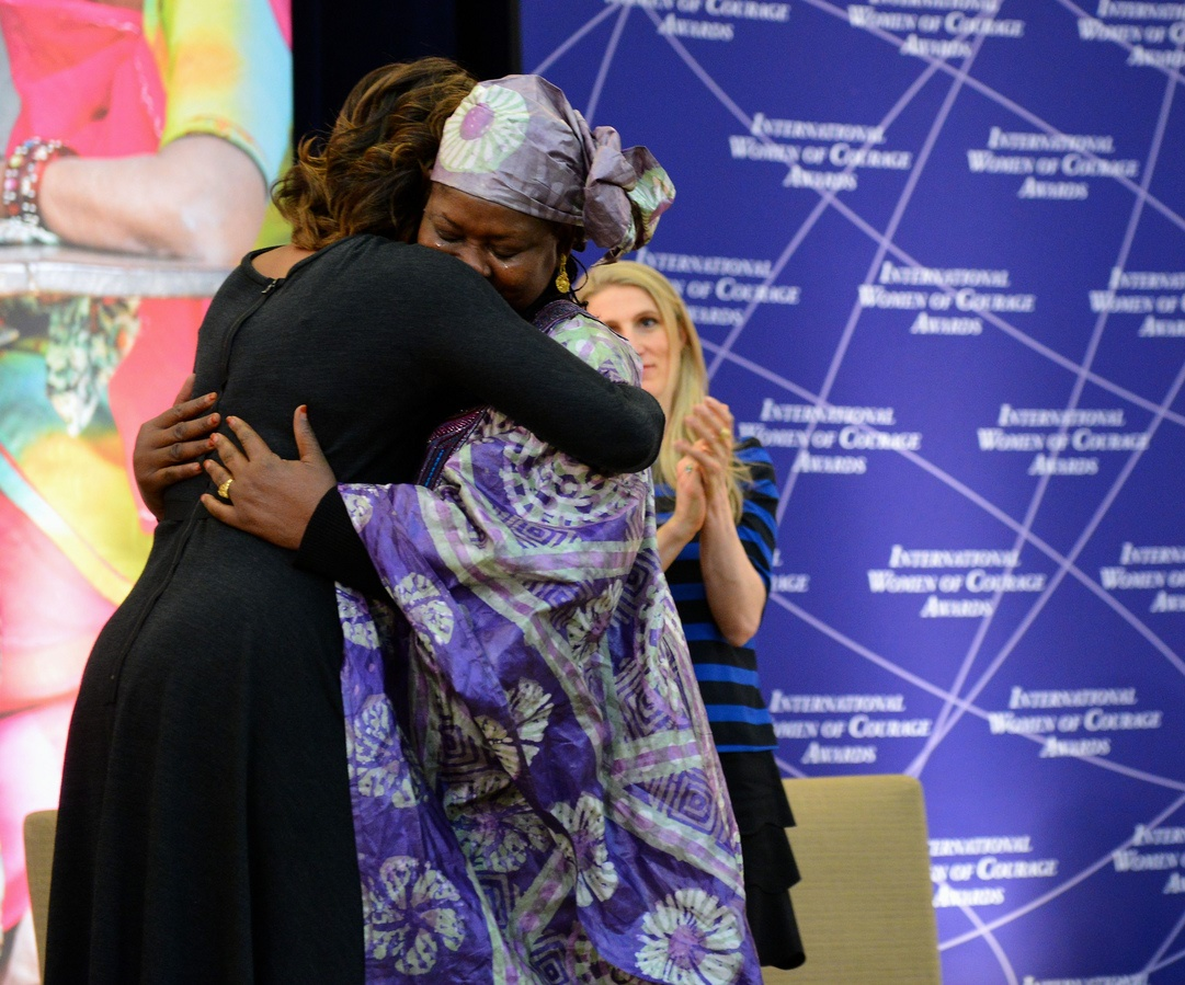 Fatimata Touré and Michelle Obama embrace during the 2014 International Women of Courage Award Ceremony.