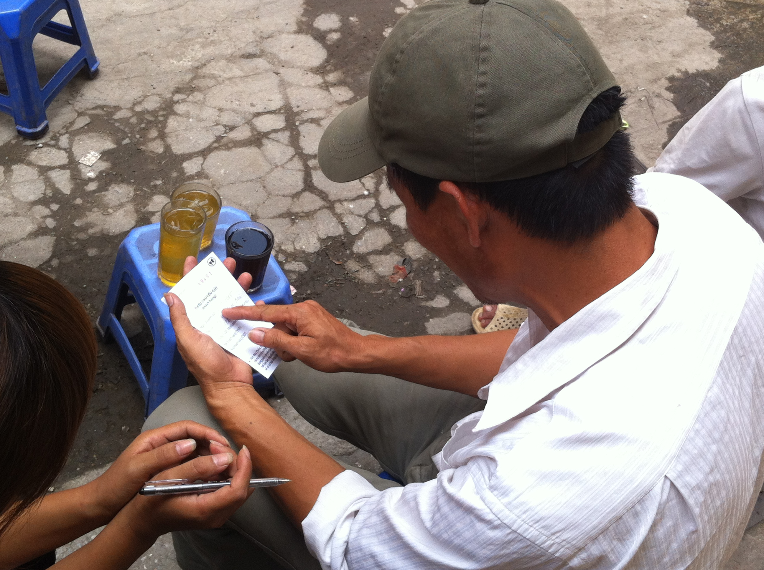 A client receives an HIV testing and counseling referral from community-based supporter in Hanoi.