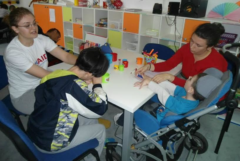 Trained professionals work with children at Bosnia's first Service Center for Children with Disabilities.