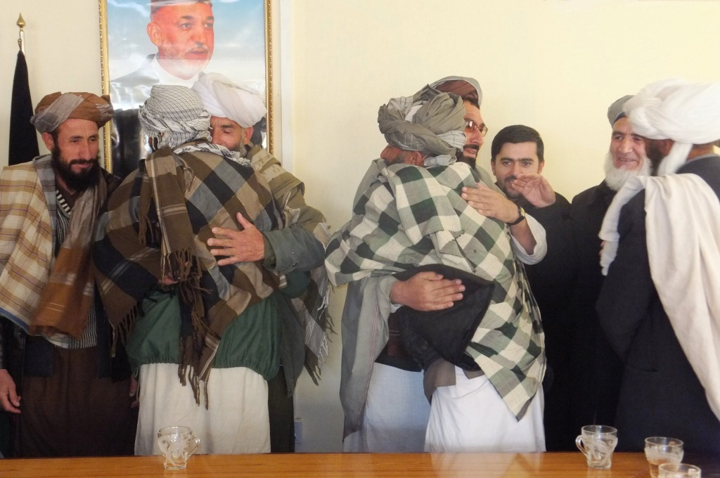 Taimani Ha tribal leaders embrace after agreement on peace deal, December 2013.