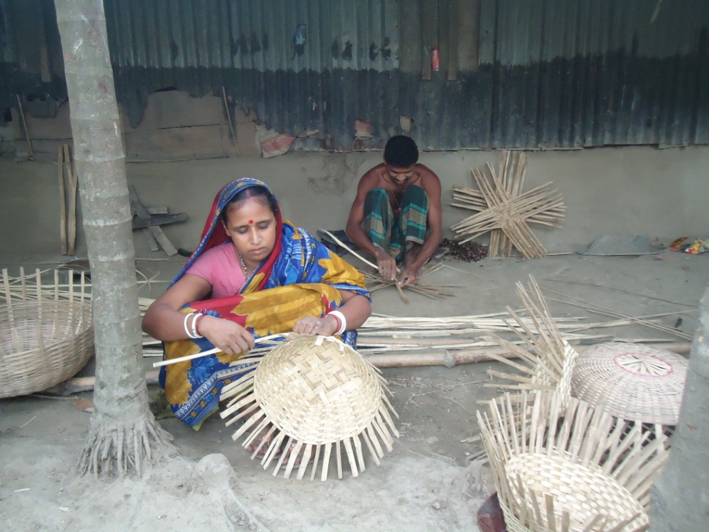 Tarango Rani crafting bamboo baskets with her husband