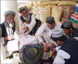 Afghan farmers cash in seed and fertilizer vouchers as part of a USAID-assisted poppy eradication program.
