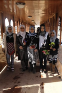 Schoolchildren on pedestrian bridge in Basra, a community project supported by USAID