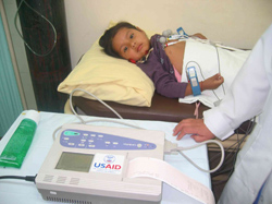 A young patient receives medical attention in the main COMBASE center in Cochabamba.