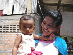 Phally plays with her niece in Battagram, western Cambodia. After her husband died of HIV/AIDS, Phally learned that she too was