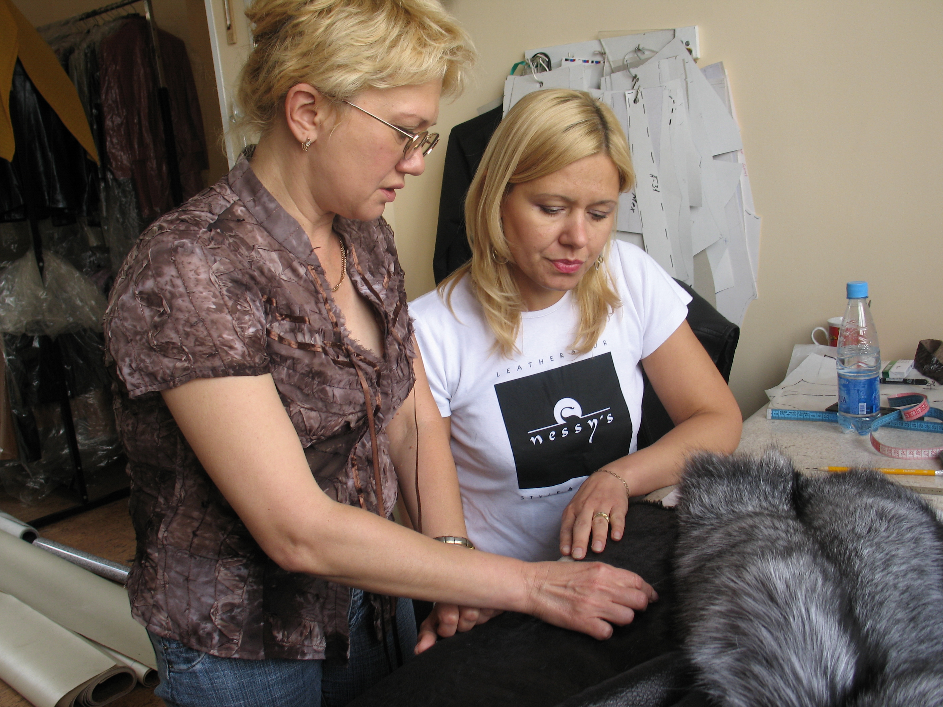 Iryna Brzak making leather and fur clothing at her workshop.