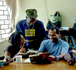 Dewdney Scott, right, prepares for Literature Circle Discussion with other students in the Fast Track Program in Kingston