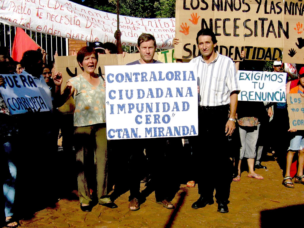"""Watchdog group members demanded accountability from a public official during their first demonstration. The sign reads """"Capitan"""